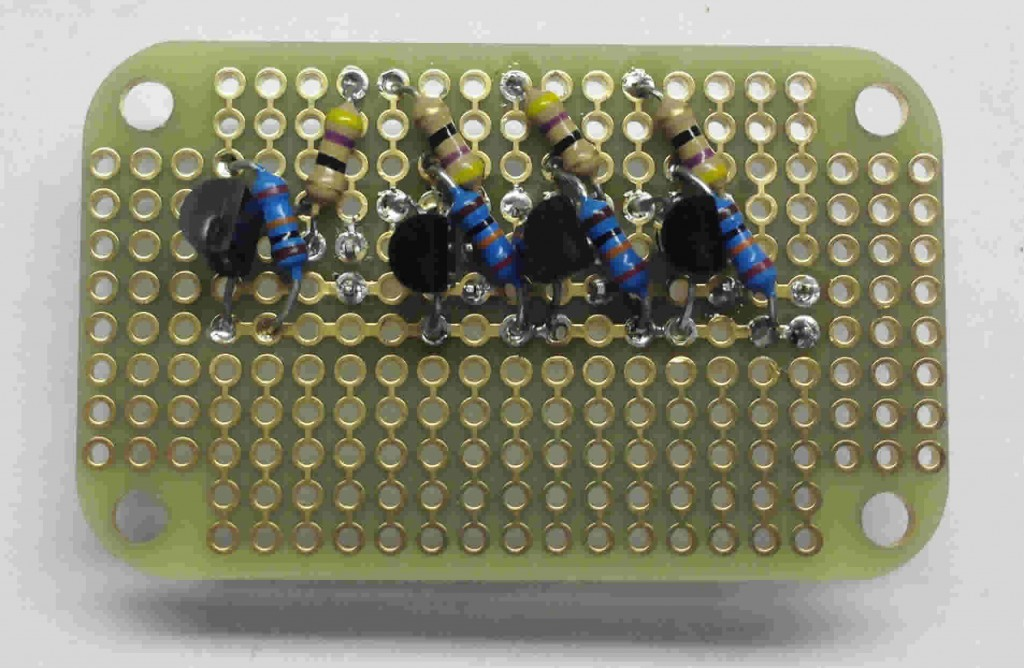 The backside of our output breadboard. Four NPN 2N7000 mosfets, four 47ohm current limiting resistors, and four 10k pull downs on our outputs.